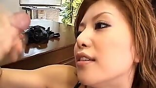 Asian mistress gives her slave a rough blowjob