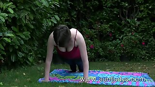 Sexy milf Inara Byrne does sexy yoga outdoors