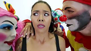 Cheeky and crazy tattooed lady fucked at the same time with three clowns.