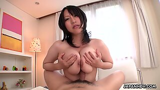 Big breasted Japanese babe rides cock in POV