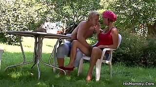 Horny mom toying his gf outdoors