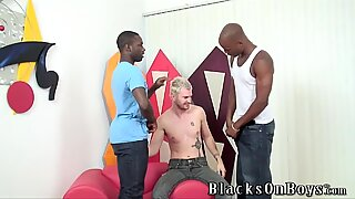 Handsome dude getting gangbanged by black men