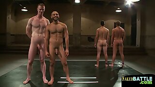 Handsome wrestling stud tugs his cock